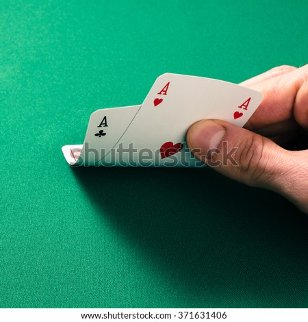 Male hand checking cards