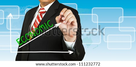 Male hand drawing a graph with Economic going up