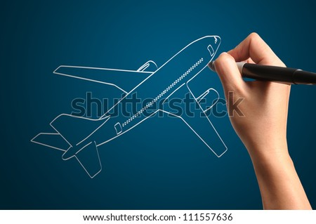 Male Hand drawing airplane - stock photo