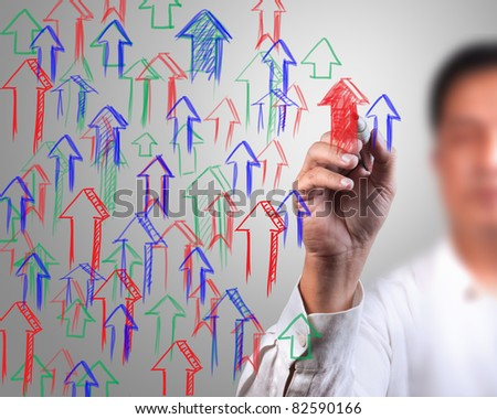 Male hand drawing on white board - stock photo