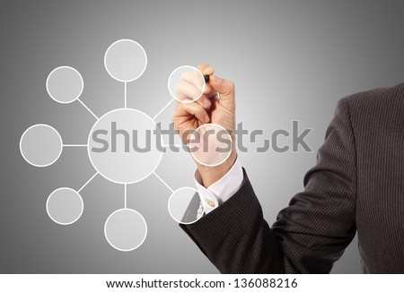 Male hand drawing social network structure, grey background - stock photo
