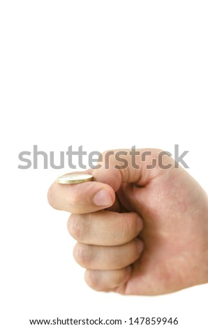 Male hand flipping a coin. Isolated over white background. Shallow depth of field. - stock photo