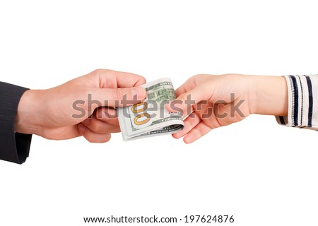 male hand gives money to a child - stock photo