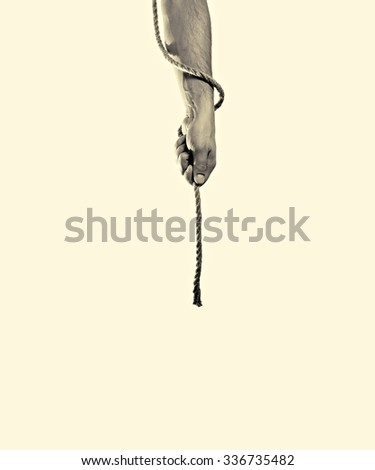 Male hand hands a rope on toned background, isolated - stock photo