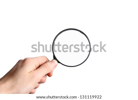 Male hand holding a black magnifying glass isolated on white background - stock photo