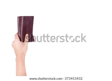 Male hand holding a book isolated on a white background - stock photo
