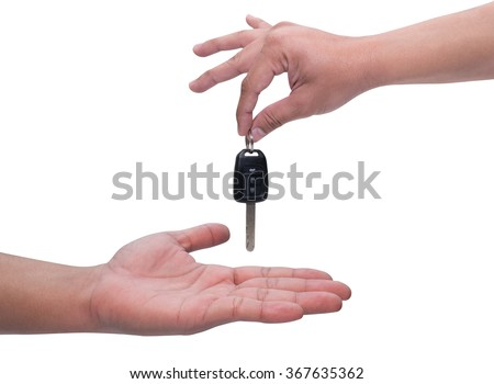 Male hand holding a car key and handing it over to another person isolated - stock photo
