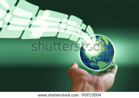 Male hand holding a glowing earth globe in globalization concept - stock photo