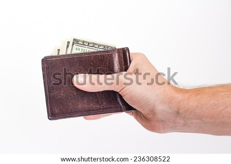 male hand holding a purse with dollar bill. isolated on white background.
