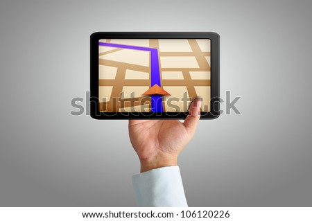 Male hand holding a touchpad gps - stock photo