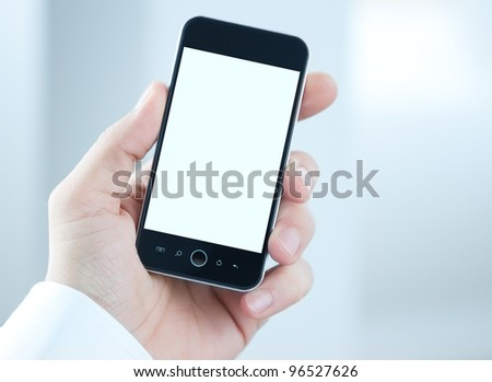 Male hand holding blank mobile smart phone with clipping path for the screen - stock photo