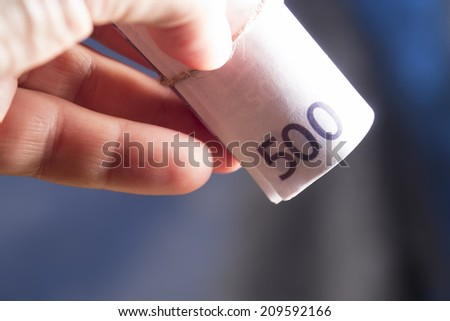 Male hand holding euro money banknotes - stock photo