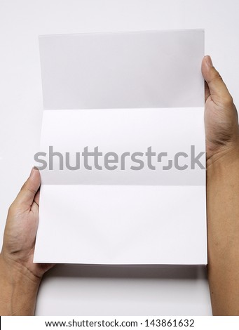 Male hand holding folded blank A4 copy space letter - stock photo