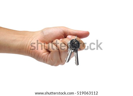 Male hand holding keys isolated