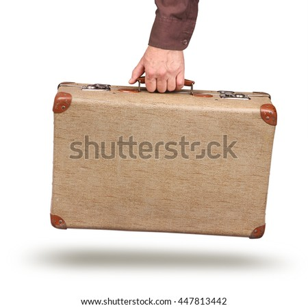 Male hand holding old vintage suitcase isolated on white - stock photo