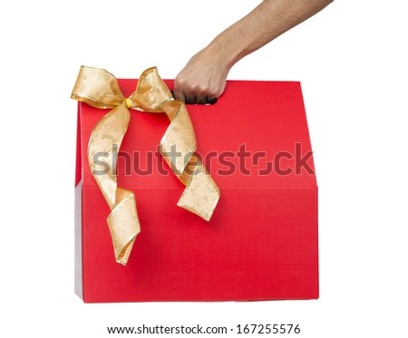 Male hand holding red gift box with a bow isolated - stock photo