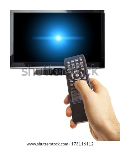 Male hand holding remote control to the TV screen with glowing blue light on screen isolated on white - stock photo