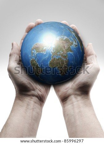 Male hand holding the Earth - stock photo
