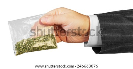 Male hand in suit with package of drugs isolated on white background - stock photo
