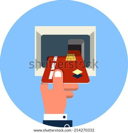 Male Hand Inserts Credit Card Into the ATM - stock photo