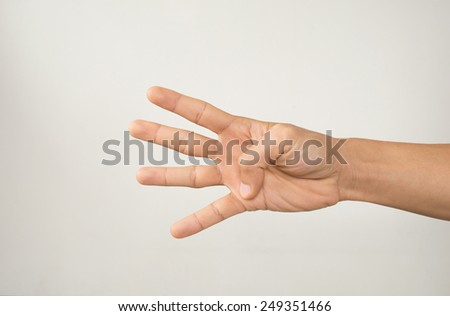 Male hand is showing four fingers. - stock photo