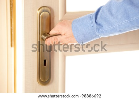 Male hand on handle, opening or closing door - stock photo