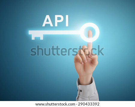 male hand pressing API key button over blue abstract background - stock photo