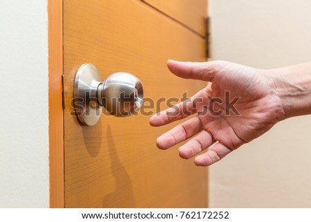 Male Hand Reaching Out To Grab A Door Knob, Good For Coming Home, Home