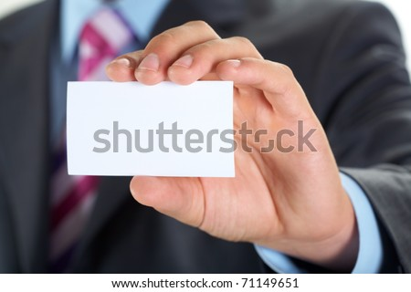 Male hand showing a business card - stock photo