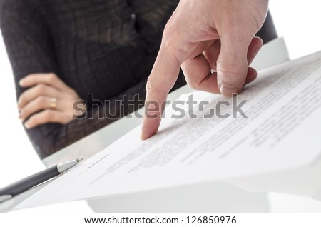 Male hand showing a woman where to sign a paper. - stock photo