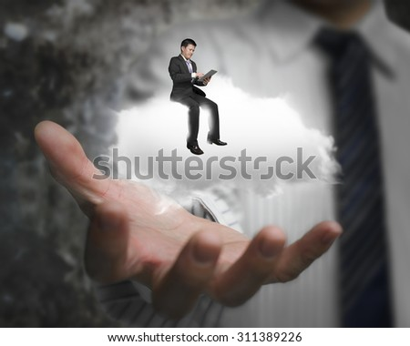 Male hand showing businessman using smart tablet sitting on white cloud - stock photo
