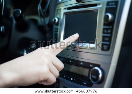 male hand touching blank screen in modern car