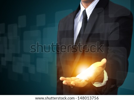 Male hand touching on a touch screen interface - stock photo