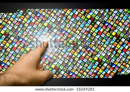 male hand touching with the finger a wall of multiple colorful micro screens