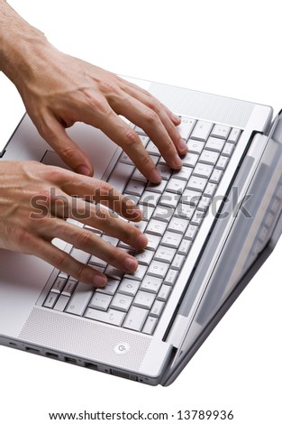 Male hand typing at a laptop keyboard isolated on white