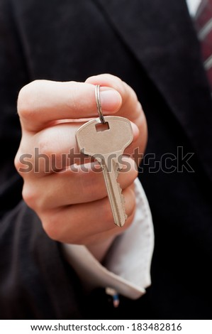 male hand with a key  - stock photo