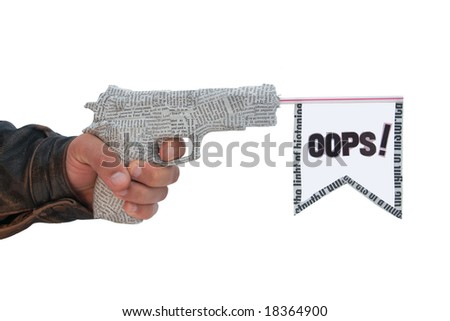 male hand with fire a shot newspaper pistol and flag on white background. oops fake - stock photo