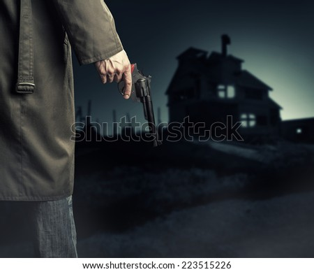 Male Hand with gun (revolver) outdoor.  Man killer looking on night house - stock photo