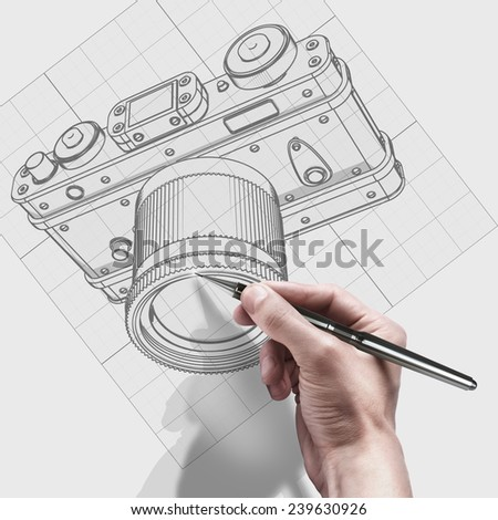 male hand with pen. engineer working on cad concept Vintage photo camera.  - stock photo