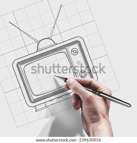 male hand with pen. engineer working on cad concept vintage TV.  - stock photo