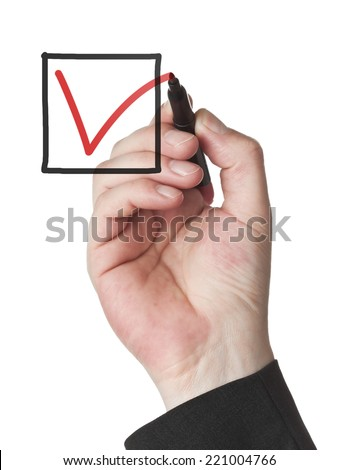 male hand with red felt tip pen marking a check box - stock photo