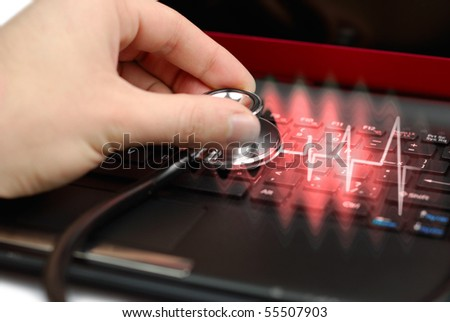 Male hand with stethoscope over black keyboard of laptop - stock photo