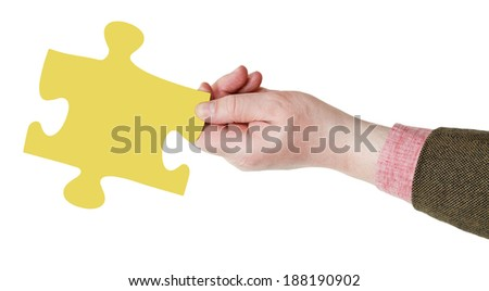 male hand with yellow puzzle piece isolated on white background