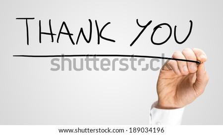 Male hand writing Thank you on virtual screen. - stock photo