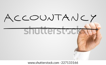 Male hand writing word Accountancy on a virtual screen with black marker. Over grey background. - stock photo