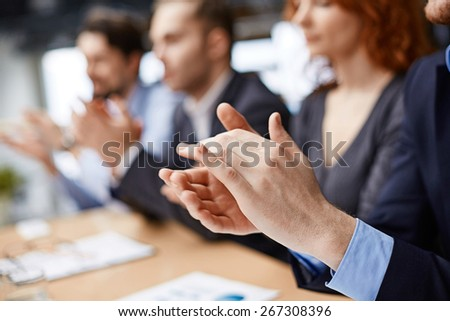 Male hands applauding at conference - stock photo