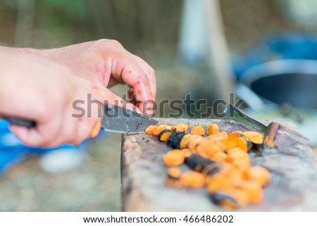 Male hands chopping carrots
