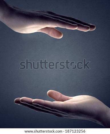 Male hands cupped on gray background with copyspace in the center. - stock photo