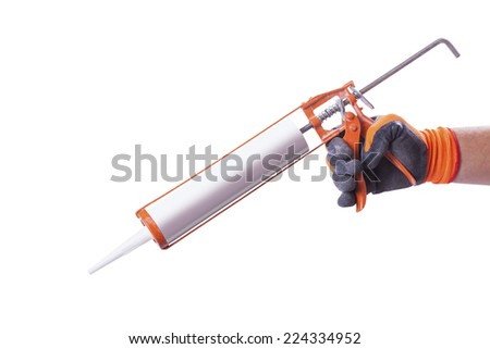 male hands gloves hold sealant gun isolated on white background - stock photo