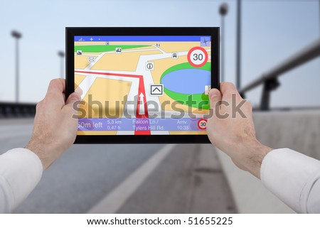 male hands holding a touchpad pc, using the navigation programme - stock photo